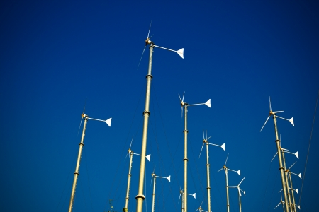 Group of wind turbine generator with blue sky photo