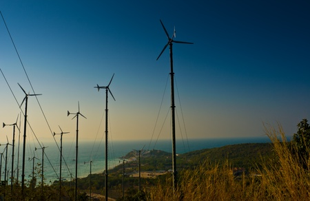 Wind turbines farm with a sunset,Pattaya Thailand Stock Photo - 8791537