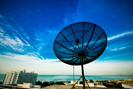 snoop: A black satellite dish on morning sky