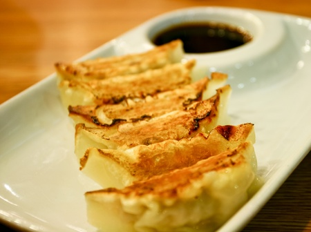 potstickers: Traditional Asian Food, Stuffed with Pork Meat or Vegetables