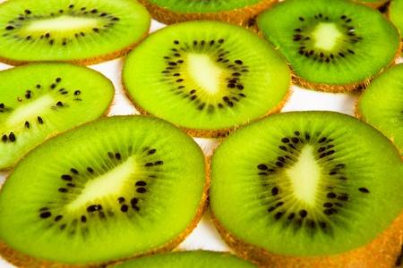 Section of kivi fruit on white photo