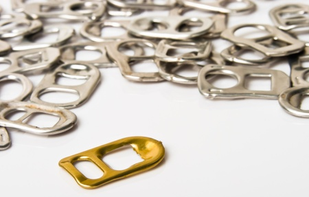 plenty of ring pulls recycle aluminium  over white background photo