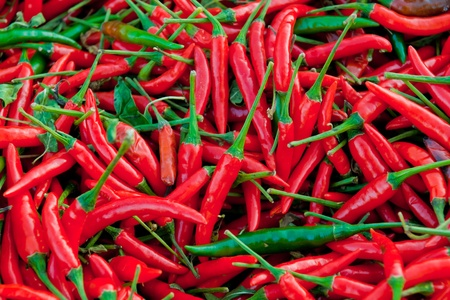 Hot  red chillies as a textured food background.