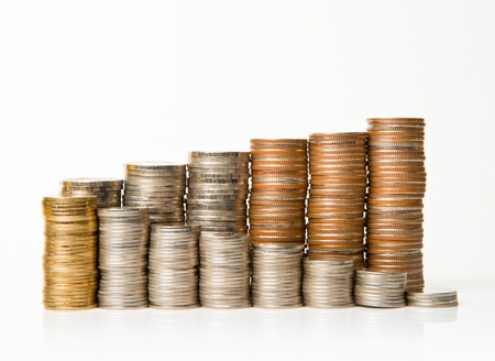 side view of stacks of coins increasing in height, on white  background Stock fotó