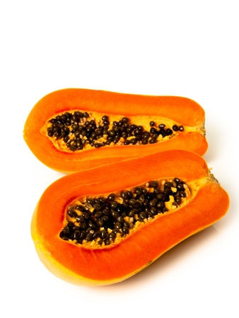 Papaya fruit sliced on half over white background. Stock Photo