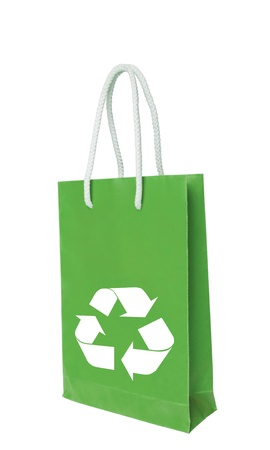 Green recycle paper shopping bag over white floor photo
