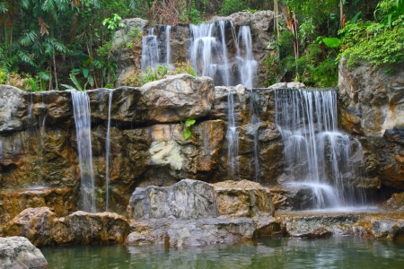 Tropical waterfall in Thailand forest Stock Photo