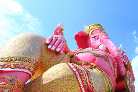 siddhivinayaka: Pink ganesha in relaxing protrait on blue sky, Chachoengsao,Thailand Stock Photo