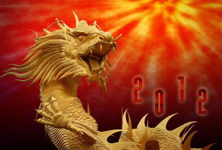 Chinese dragon statue with happy new year 2012 background photo