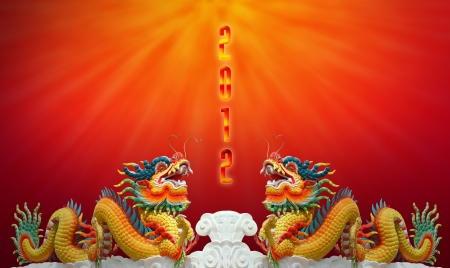 Chinese dragon statue with happy new year 2012 background