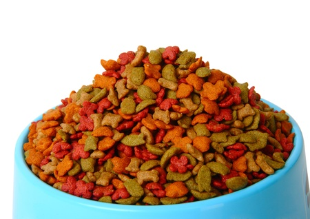 Dry pet food in bowl isolated on white background Stock Photo - 11065771