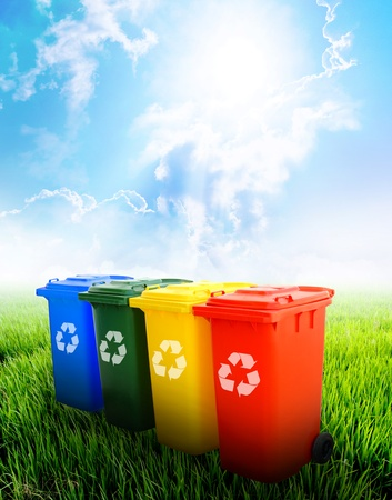 reciclar: Colorful recycle bins ecology concept with landscape background.