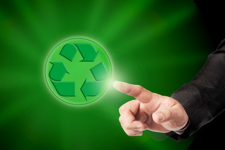 environmentalist tag: Male hand and recycle sign for green world concept  Stock Photo