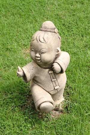 Chinese fighter statue on grass field in the garden of chinese  temple.  photo