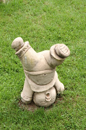 guard house: Chinese fighter statue on grass field in the garden of chinese  temple.  Stock Photo