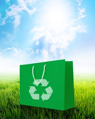 Green recycle paper shopping bag with nature background. photo
