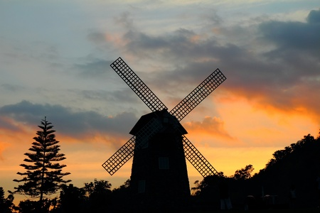 Silhouettes of windmill at sunset, at Thailand Stock Photo - 12018226