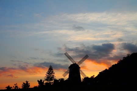 Silhouettes of windmill at sunset, at Thailand Stock Photo - 12018224