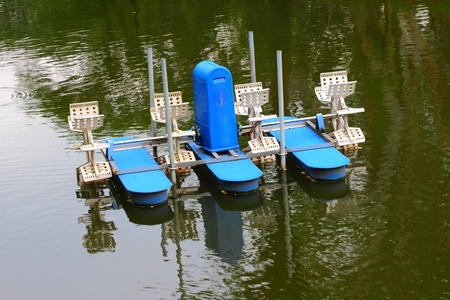 A water wheel floating on the lake of park  photo