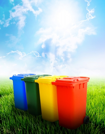 Colorful recycle bins ecology concept with landscape background  Stockfoto