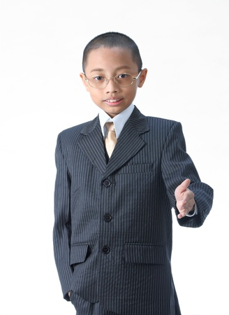 A young boy in suit ready to set a deal over white background photo