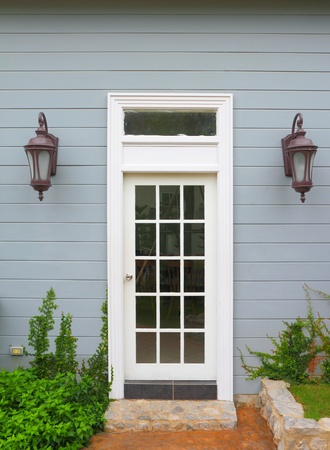 White wooden vintage door to the house  photo