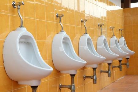 white porcelain urinals in public toilets