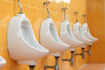 white porcelain urinals in public toilets  photo