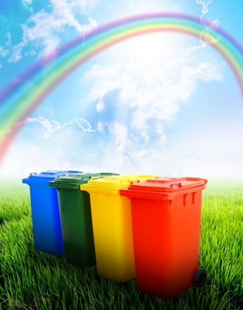 Colorful recycle bins  with landscape background  photo