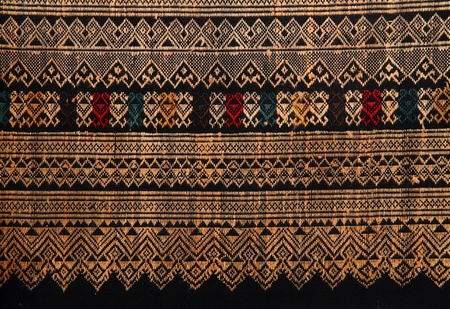 Traditional hand-woven fabrics in Thai pattern design photo