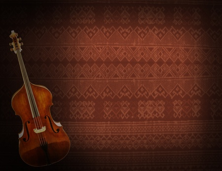 Old violin on vintage fabric background photo