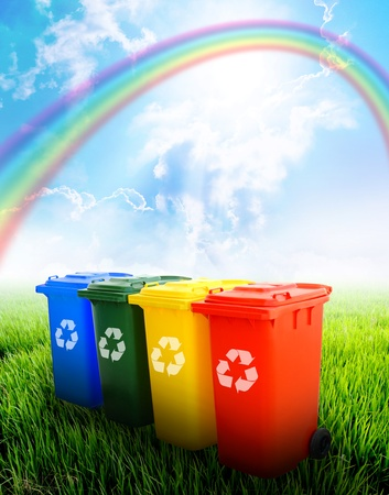 waste disposal: Colorful recycle bins ecology concept with landscape background  Stock Photo