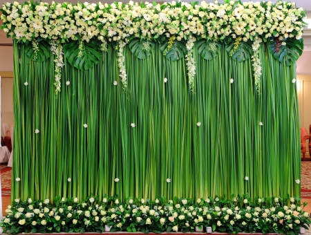Green backdrop flowers arrangement for wedding ceremony