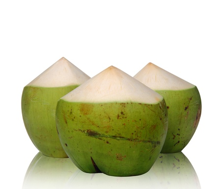 Green Coconut with reflect on white background photo