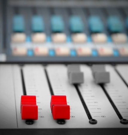 Close up of red audio sound mixer  photo