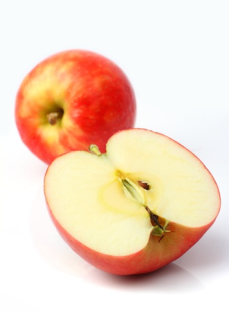 One red apple and slice isolated on a white background Фото со стока