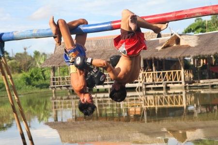PATTATA - THAILAND - AUGUST 21: Unidentified men fight for ocean boxing in Pattaya floating market on August 21, 2011. at Pattaya Chonburi, Thailand. Ocean boxing is a  tradition of Thailand.