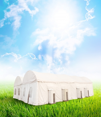 Closed white tent with air conditioning on nature background  Stock Photo