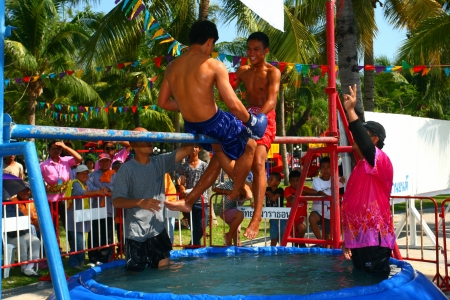 PATTATA - THAILAND - APRIL 20: Unidentified young men fight for ocean boxing in Songkran festival (Water Festival)  on April 20, 2010. at Pattaya City Chonburi, Thailand. Ocean boxing is a  tradition of Thailand.