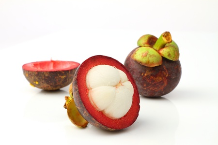 Mangosteen, the queen of tropical fruit over white