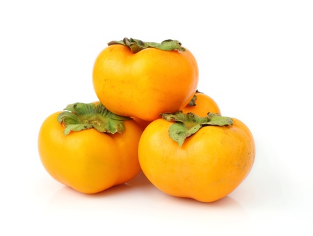Persimmon tropical fruit isolated in white background