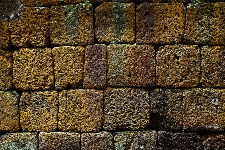 Laterite wall, The ancient castle in Thailand. photo