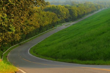 sharp curve: Sharp curve of way down the hill  Stock Photo