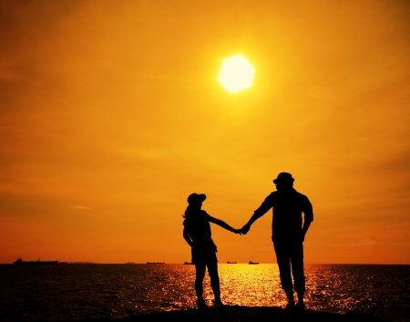 Silhouette of a young couple on sunset  Stock Photo
