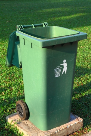degradable: Green plastic trash recycling container in the park