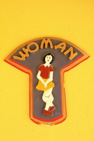 Toilet women sign on  wall photo