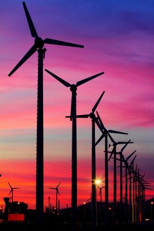 Wind turbine silhouettes at twilight, at Thailand photo