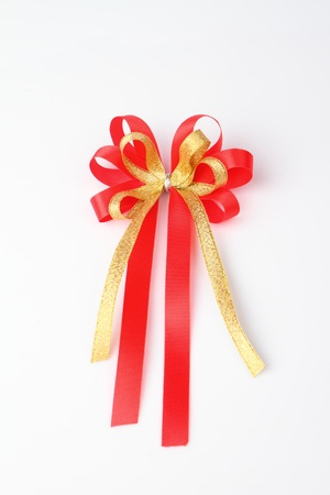 ribbin: red and gold ribbon isolated on white background Stock Photo
