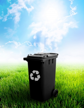 Black Recycle Bin With Landscape Background  Stockfoto