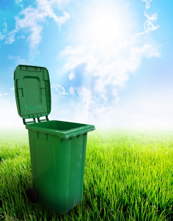 dustbin: Green plastic trash recycling container ecology concept, with landscape background